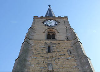 The 15th century tower of St Leonard & St Mary Church